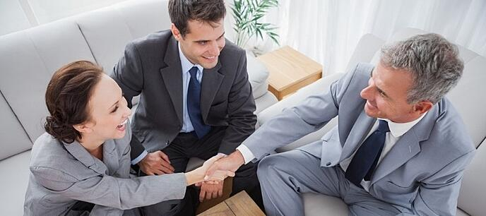 Business people shaking hands while working in cosy meeting room-500478-edited.jpeg
